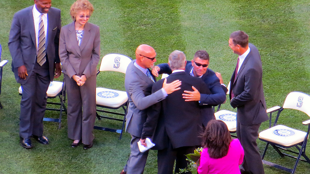 Jay Buhner and Edgar Martinez  hugging Lou with Dan Wilson on deck.